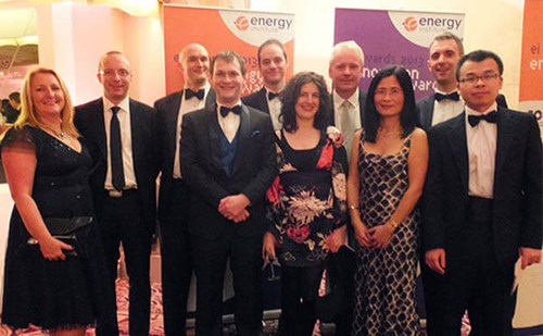 Photo of Dr. Jun Zhang with the Atmos International team at the EI Awards 2013