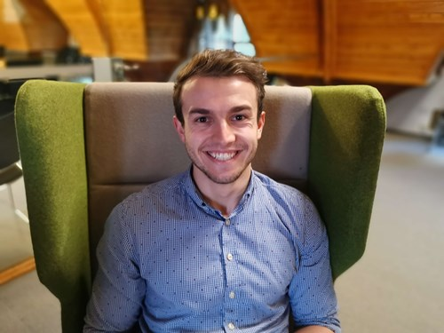 Connor Tebb, Project Engineer from Atmos International sitting in green chair